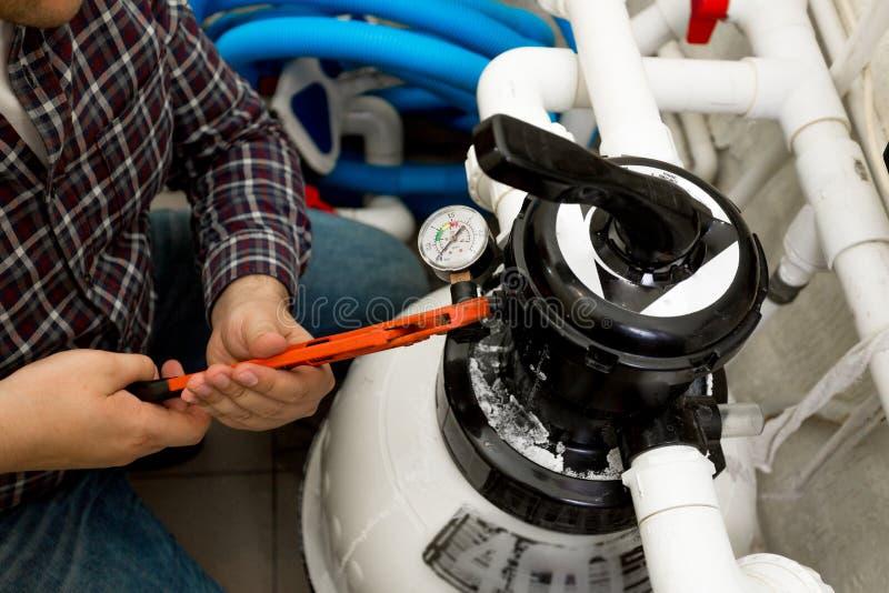 Handyman installing manometer on high pressure system. Closeup shot of handyman installing manometer on high pressure system royalty free stock photos