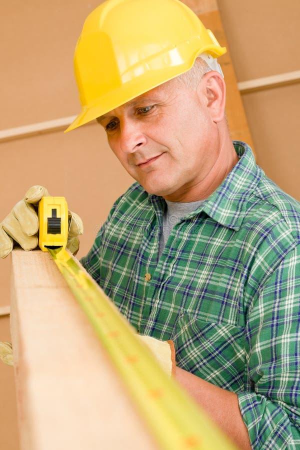 Download Handyman Mature Carpenter Measure Wooden Beam Stock Photo - Image: 21076046