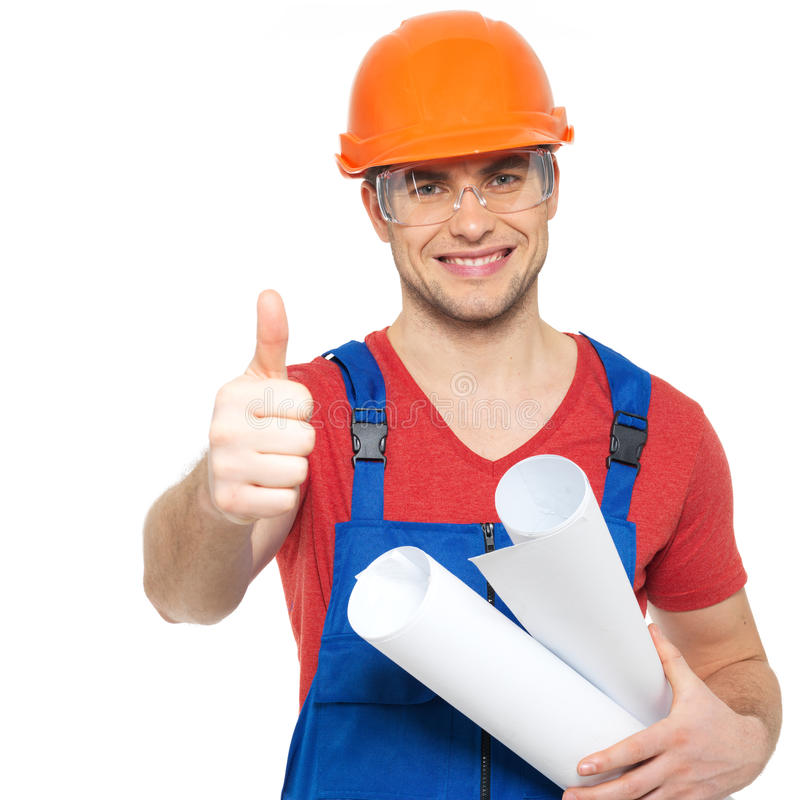 Handyman with paper showing thumbs up sign. Portrait of smiling handyman with tools and paper showing thumbs up sign isolated on white background royalty free stock image