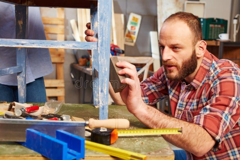 Handyman polishing wooden surface royalty free stock photos
