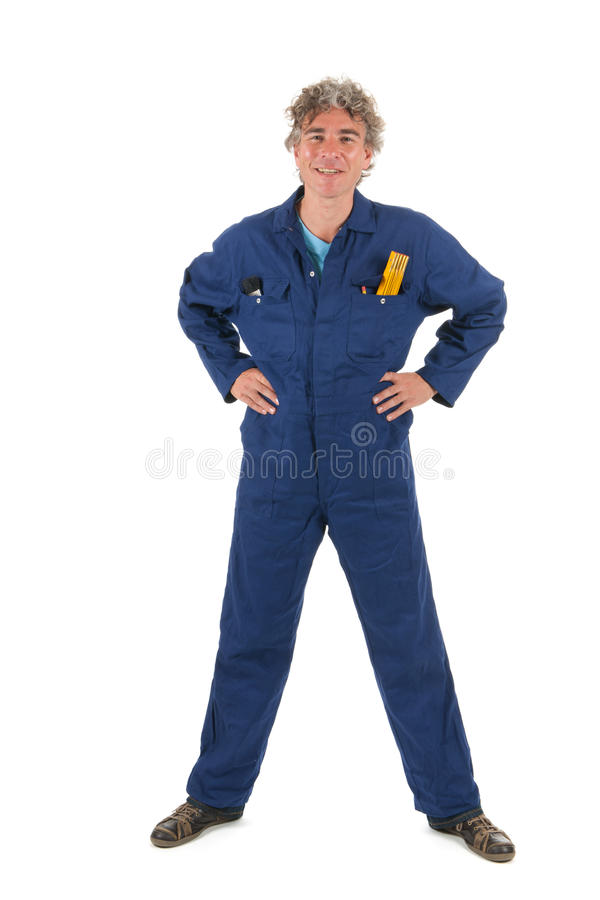 Handyman ready for the job. Handsome handyman in blue overall ready for the job stock image