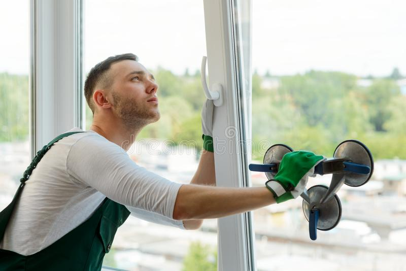 Handyman is repairing a window royalty free stock photo