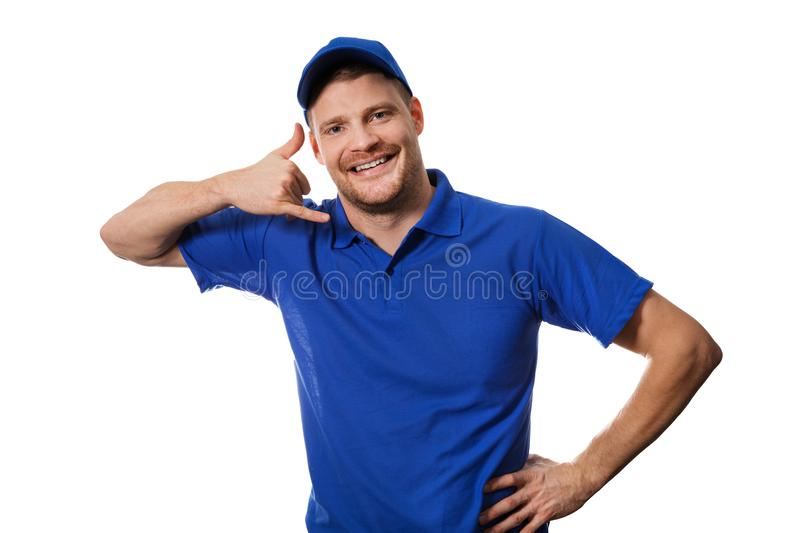 Handyman services - worker in blue uniform making call gesture royalty free stock images