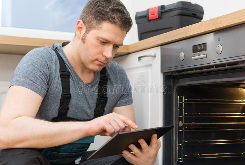 Handyman with tablet pc stock images