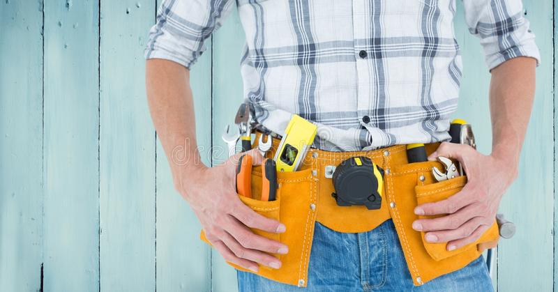 Handyman with tool belt at home royalty free stock photo