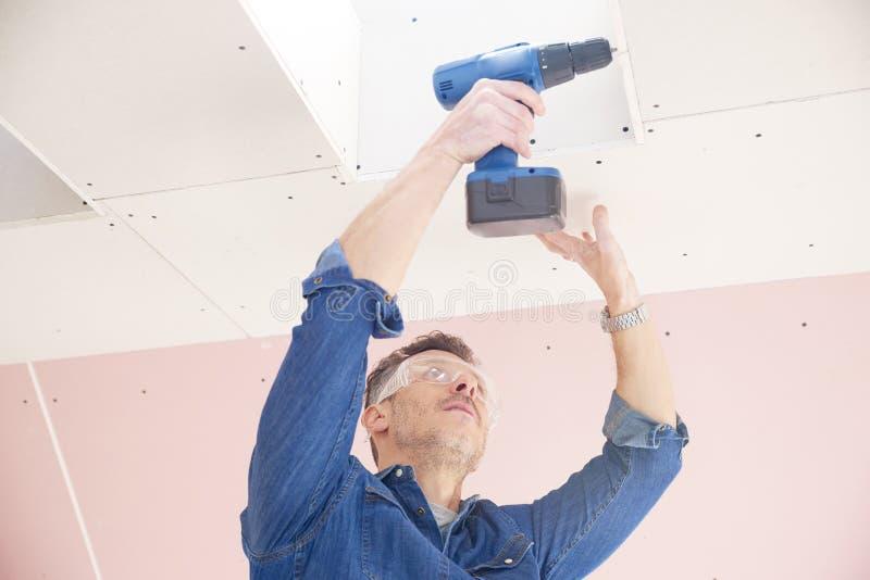 Handyman using drill stock photography