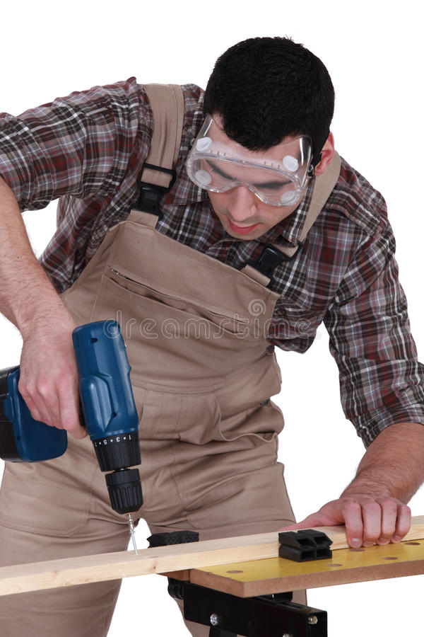 Download Handyman Using A Screwdriver Stock Image - Image: 26702529