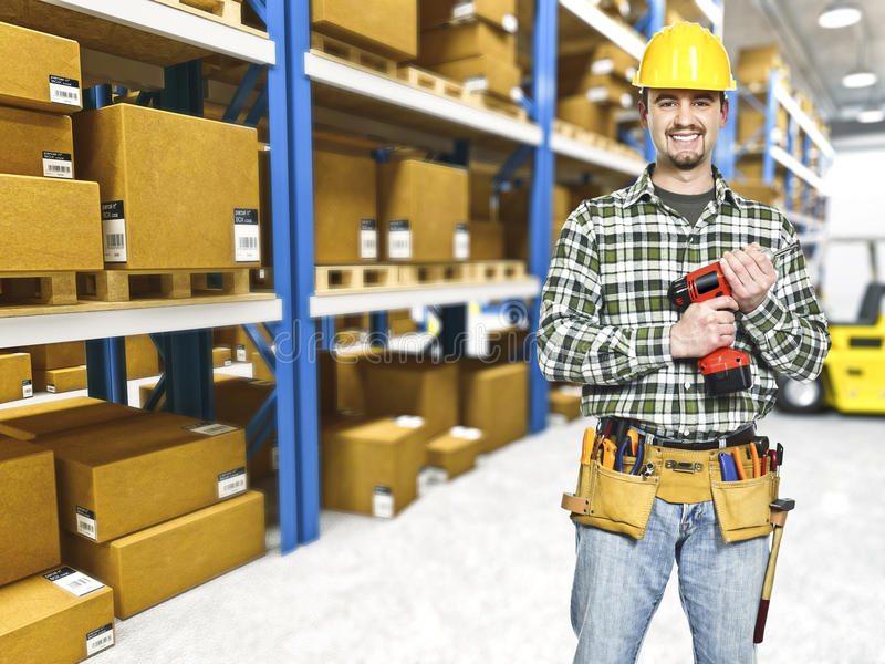 Handyman in warehouse royalty free stock photography