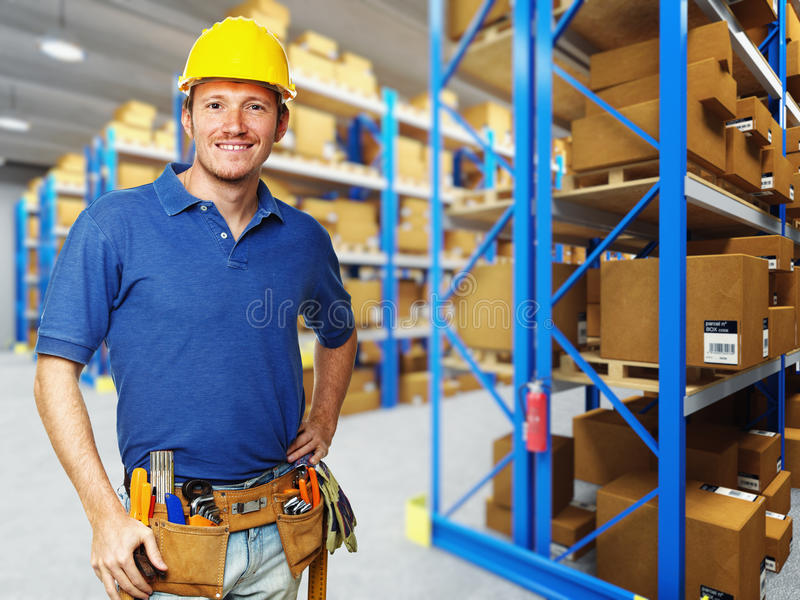 Download Handyman in warehouse stock photo. Image of uniform, container - 16888504