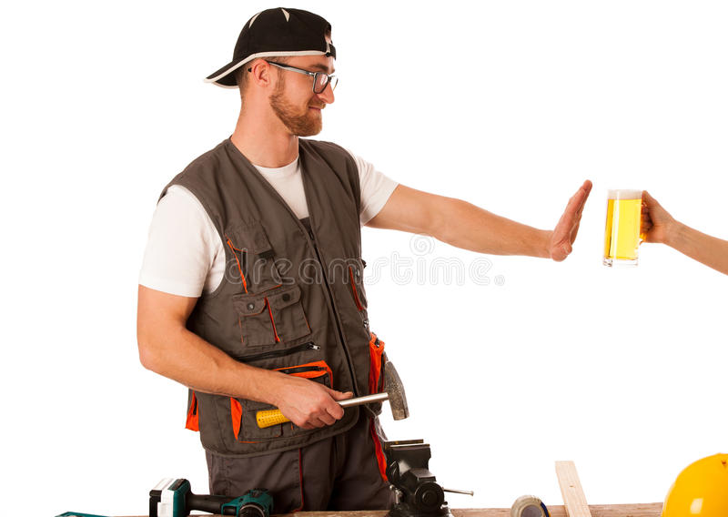 Handyman in work clothing refusing beer, don't drink on workplac stock image