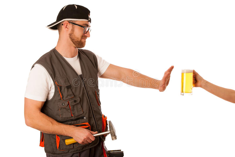 Handyman in work clothing refusing beer, don`t drink on workplac royalty free stock photo
