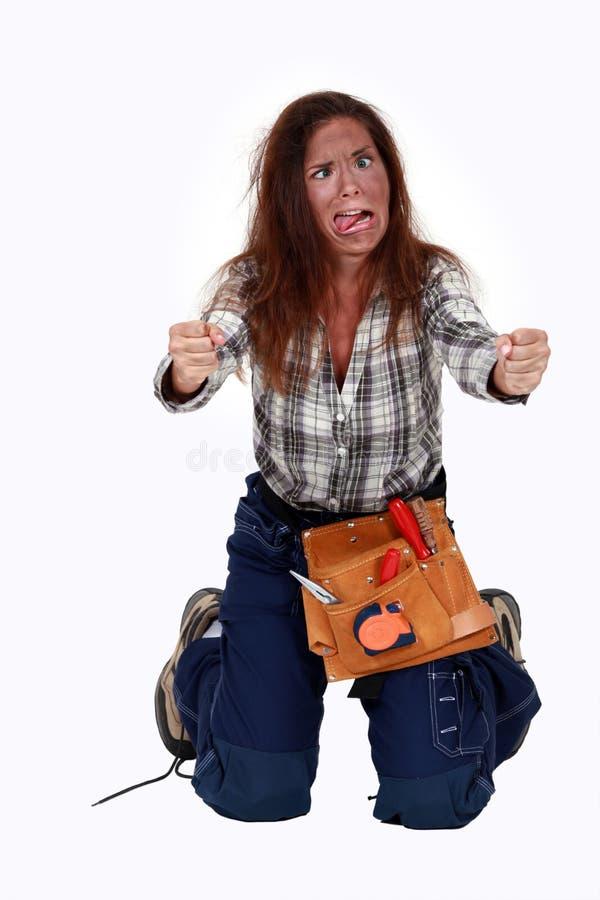 A handywoman suffering electrical shock. stock photos
