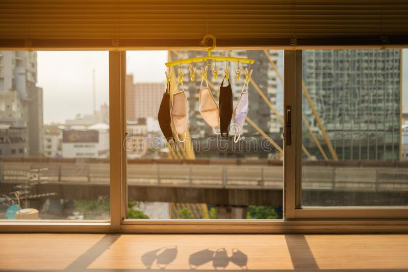 hang dry the conton masks on the window royalty free stock photography