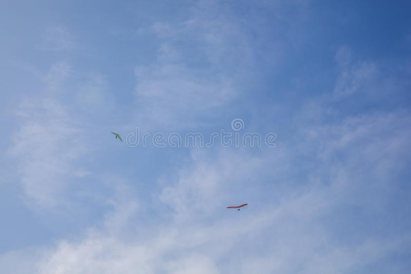The hang glider. Above the blue sky stock photos