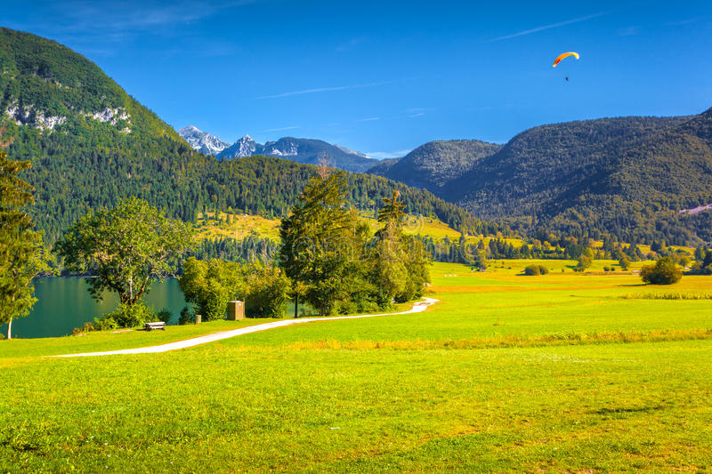 Hang-glider against blue sky stock photography