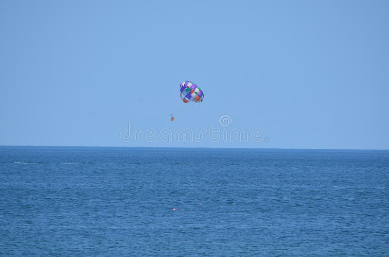 Hang glider At Cape Cod at the Jetty. On the beach at Cap Cod on the beach in summer time with a beautiful hang glider royalty free stock photos