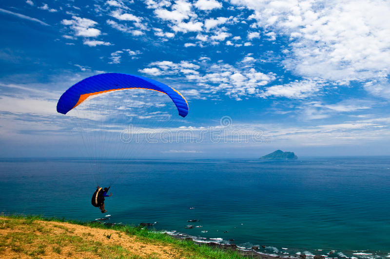 Hang Glider In Sky Over Blue Sea Royalty Free Stock Photo