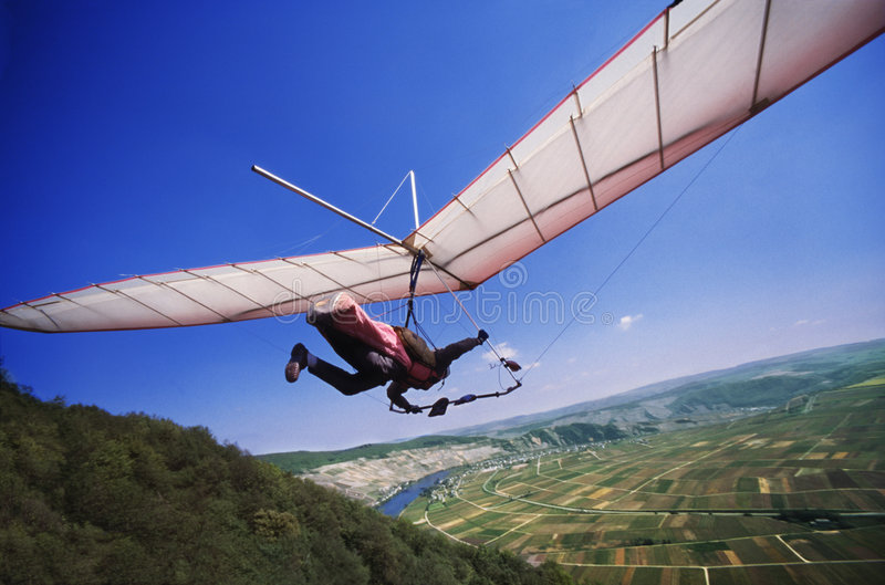 Hang glider start from a ramp stock images