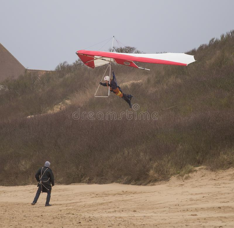 Hang gliding in Weston Super Mare 2019. Hang gliding is an air sport or recreational activity in which a pilot flies a light, non-motorised foot-launched heavier royalty free stock photos