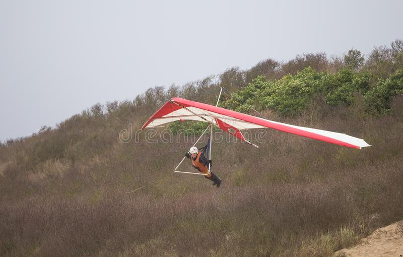 Hang gliding in Weston Super Mare 2019. Hang gliding is an air sport or recreational activity in which a pilot flies a light, non-motorised foot-launched heavier royalty free stock photography