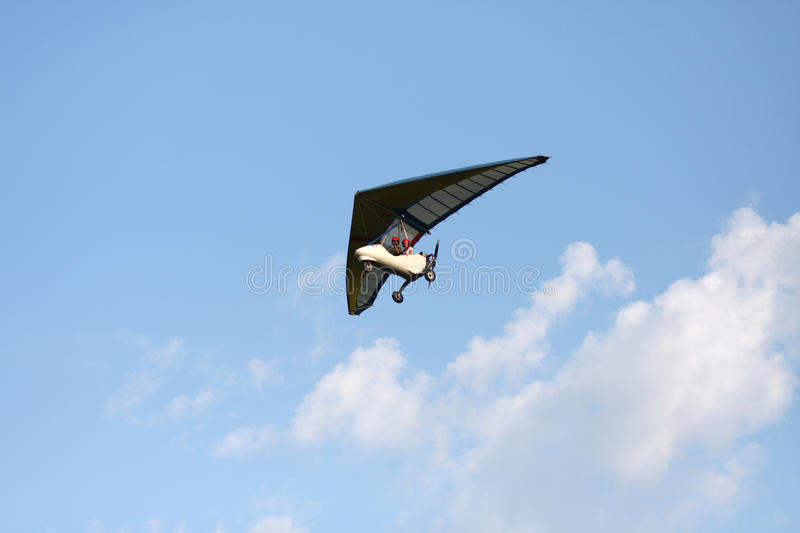 Hang gliding is flying in the sky stock image