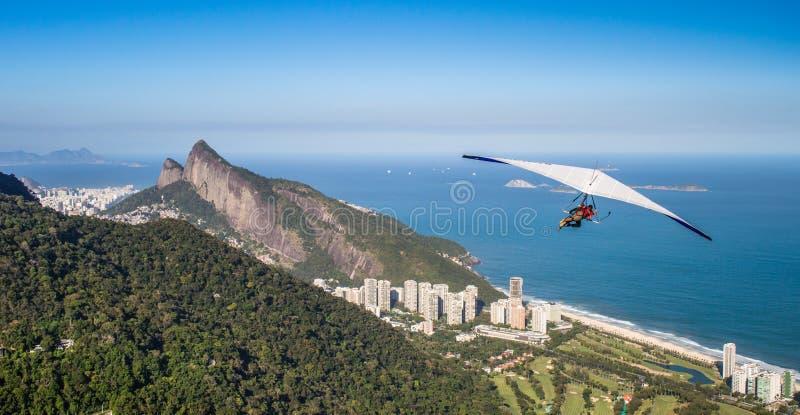 Hang gliding off Pedra Bonita in Rio de Janeiro, Brazil stock photo