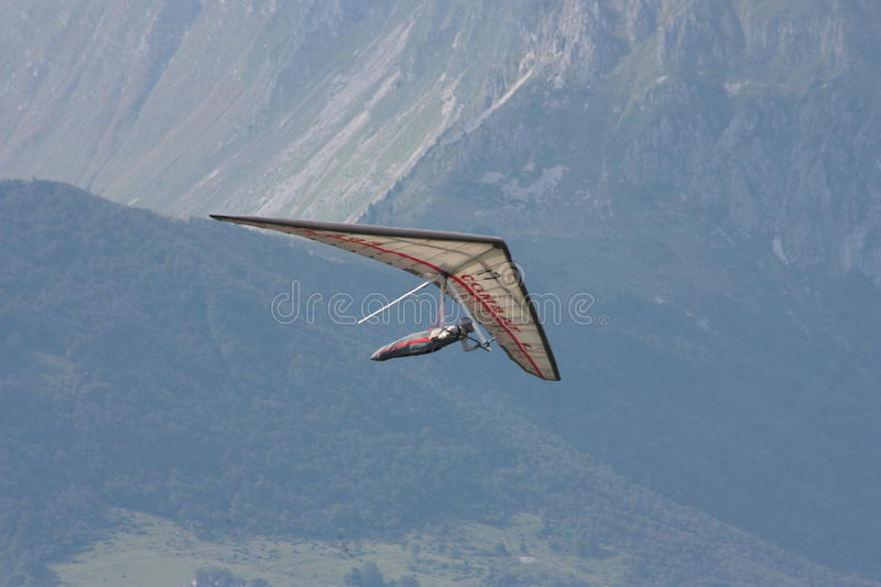 Hang gliding in Swiss Alps royalty free stock photography