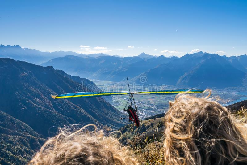 Hang-gliding in Swiss Alps from top of Rochers-de-Naye, near Montreux, Canton of Vaud, Switzerland. Sports Concept royalty free stock image