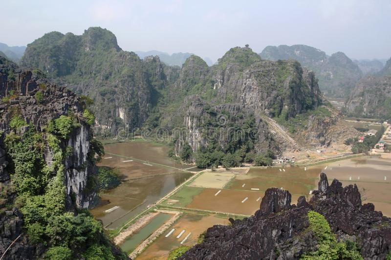 A panorama from Hang Mua, Ninh Binh, Vietnam. Hang Mua is a trek up with many of limestone steps worth efforts for impressive panoramic view of Tam Coc, Trang An royalty free stock photos