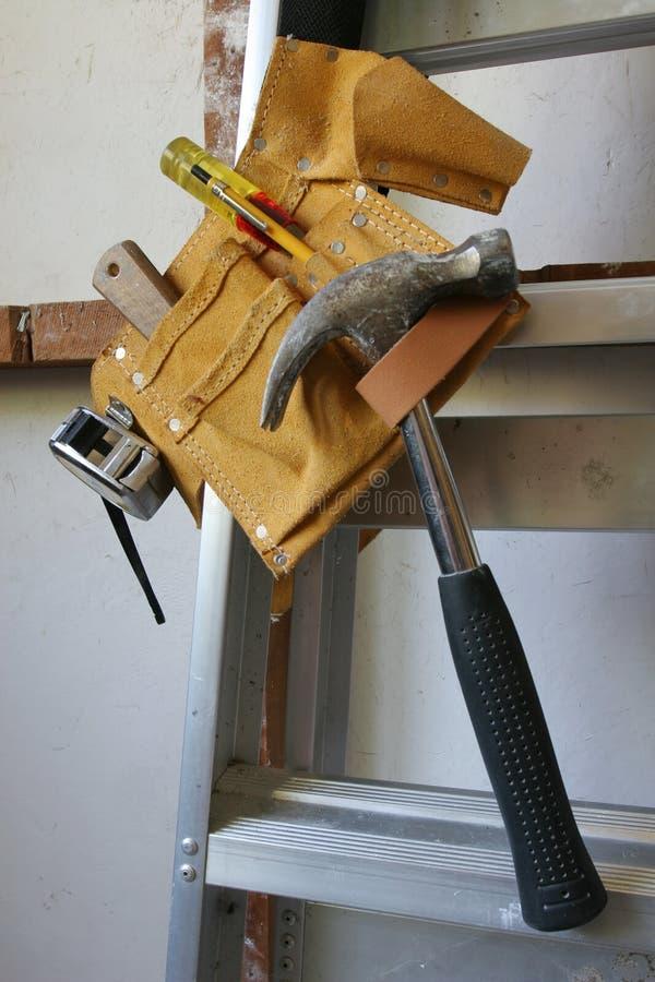 hang tools upp ditt royaltyfria foton