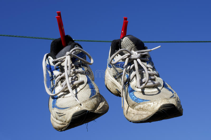 Hang up your old running shoes stock photo
