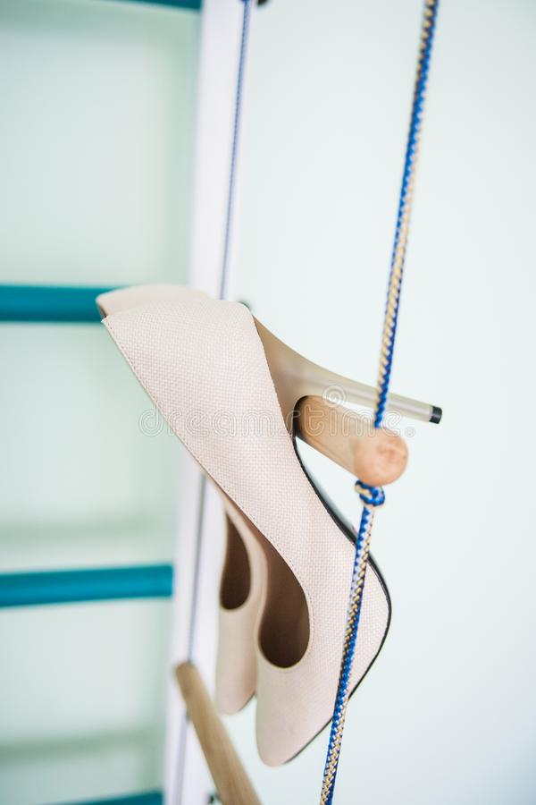 Hang wedding beautiful white shoes stock images