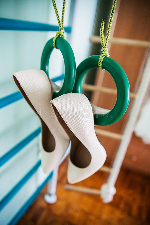Hang wedding beautiful white shoes. Beautiful bride stock photography
