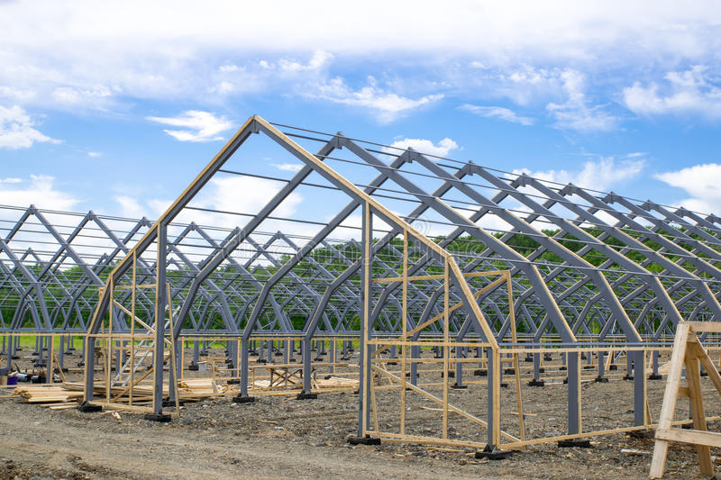 Hangar. The construction of the metal hangar greenhouse for plants royalty free stock photo