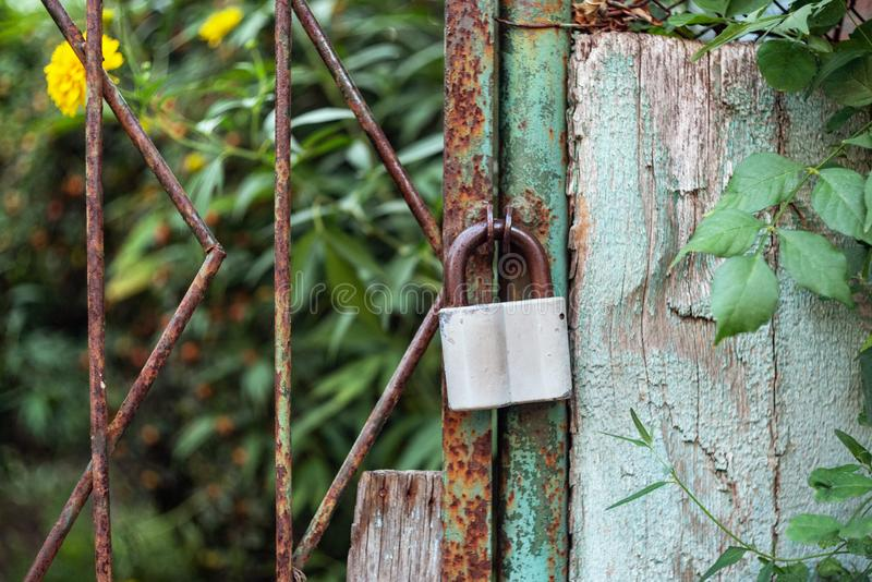 Hangar lock hanging on the door. Of a country cottage royalty free stock images