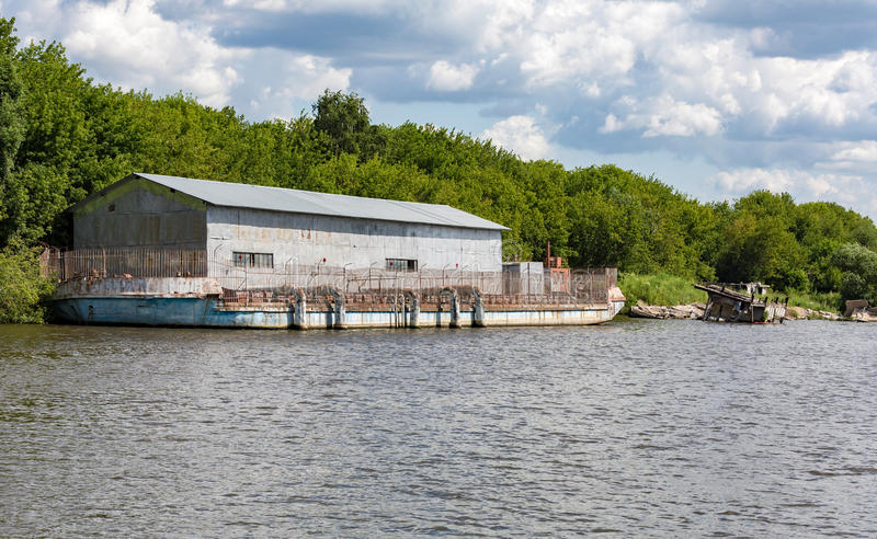 Hangar on the river barge stock photography