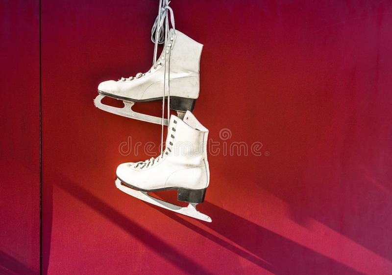Hanged Pair of White Leather Figure Skates royalty free stock photos