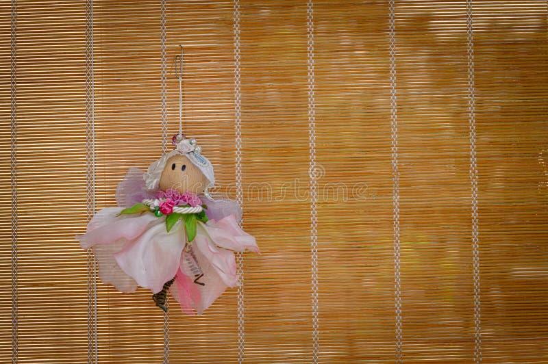 Hangende fee in het houten gordijn royalty-vrije stock afbeeldingen