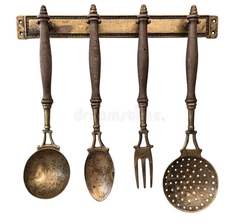 Hangende Kokende hulpmiddelen Uitstekende keukenlepel en vork Bestek voor het koken van geïsoleerde witte achtergrond stock fotografie