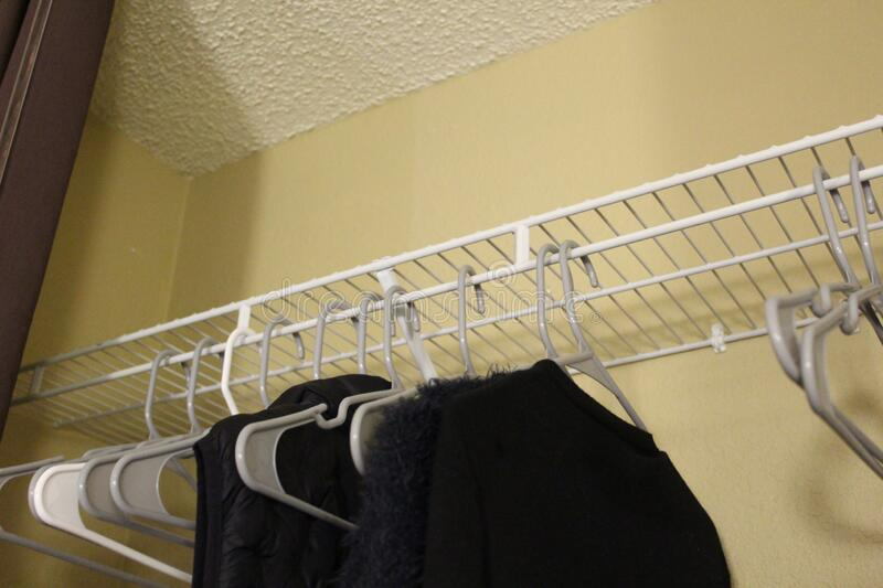 Hotel in Gainesville, Florida, United States. Hangers in a closet in Gainesville, Florida, United States. Color Digital Photography stock photography