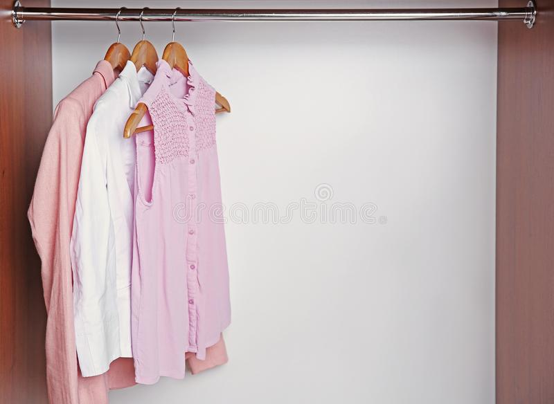 Hangers with female shirts on clothes rail royalty free stock image