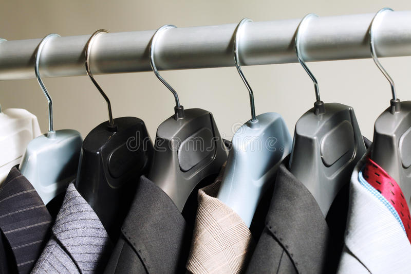 Hangers with suits stock photography