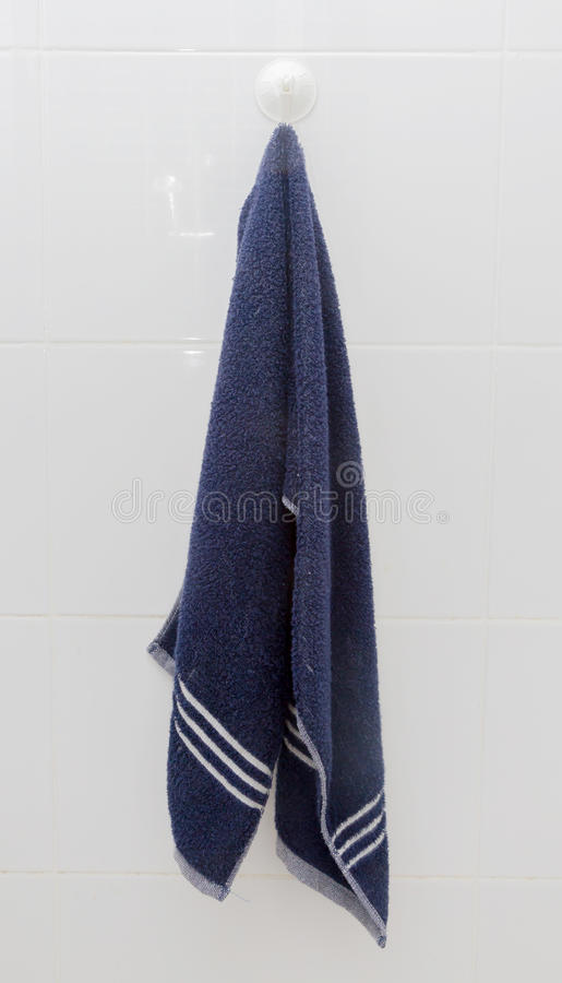Free Hanging Blue Towel At Suction Cup Hook. Stock Photography - 44830582