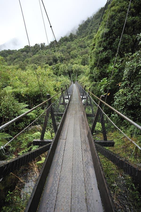 Hanging bridge in the mountainous area stock photos