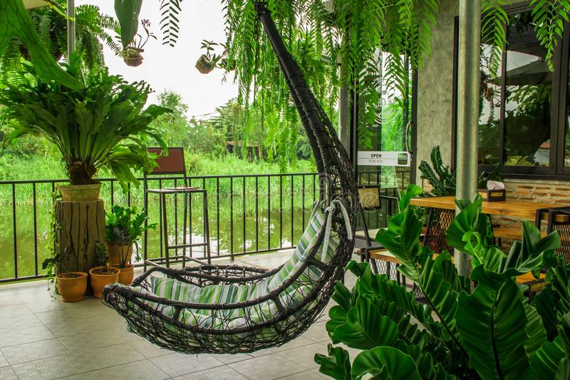 Download Vintage Hanging Chair With Green Seat Stock Photo   Image Of  Rattan, Garden: