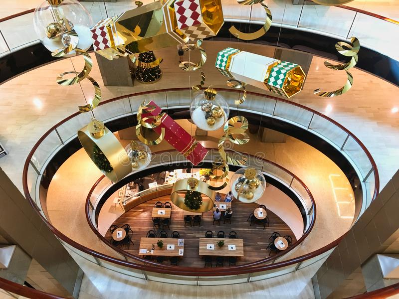 Hanging Christmas Decorations in Modern Shopping Mall. Large ornate Christmas decorations hanging in the void of a multi level modern shopping mall or centre royalty free stock photo