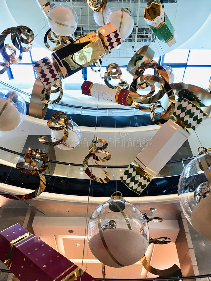 Hanging Christmas Decorations in Modern Shopping Mall. Large ornate Christmas decorations hanging in the void of a multi level modern shopping mall or centre stock photos