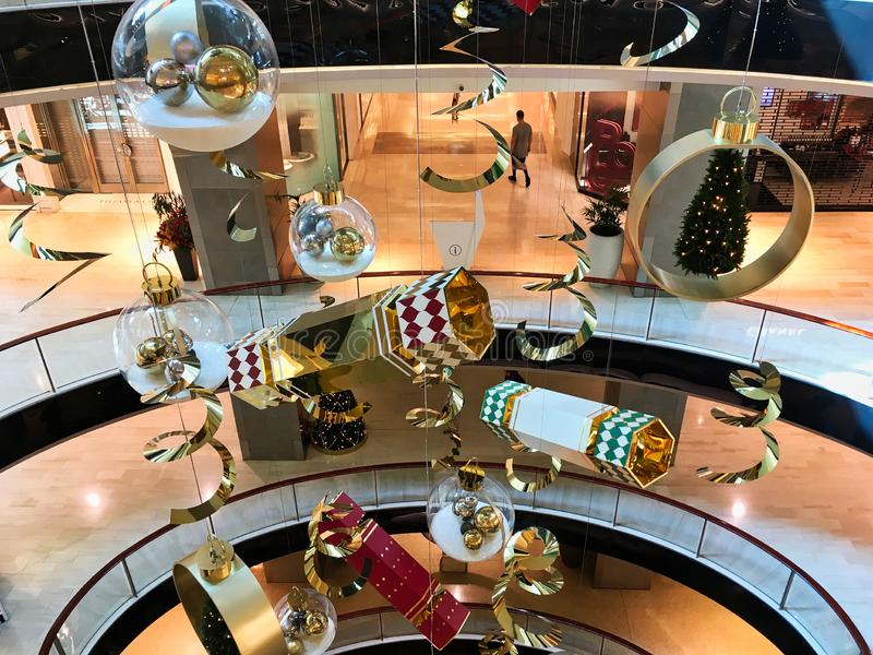 Hanging Christmas Decorations in Modern Shopping Mall. Large ornate Christmas decorations hanging in the void of a multi level modern shopping mall or centre royalty free stock images