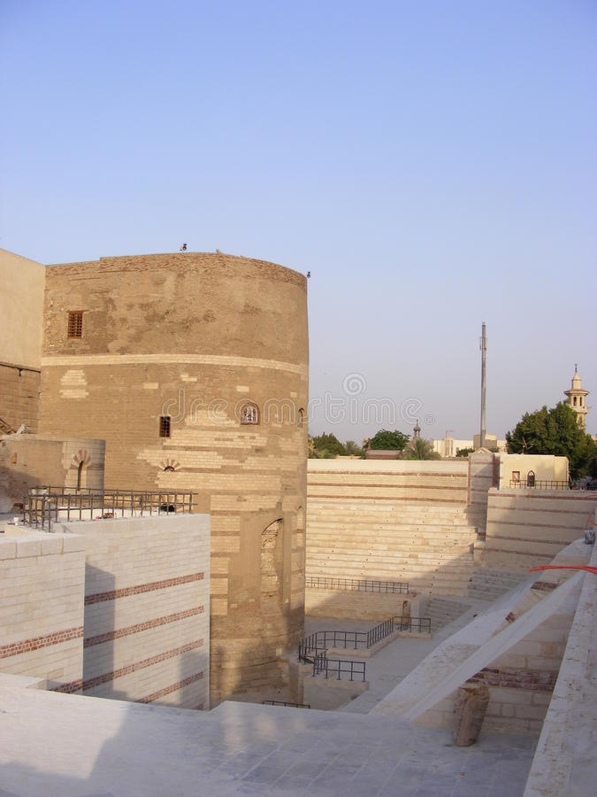 Old roman tower of Babylon in Coptic area of Cairo. Entrance from the street of Hanging Church (El Muallaqa). Old roman tower of Babylon in Coptic area of Cairo stock images