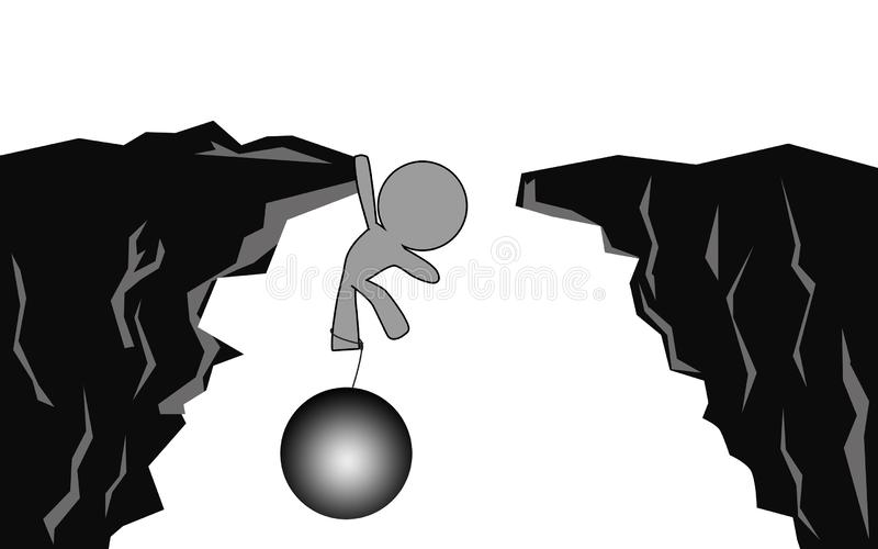Hanging on cliff with metal ball and chain stock photo